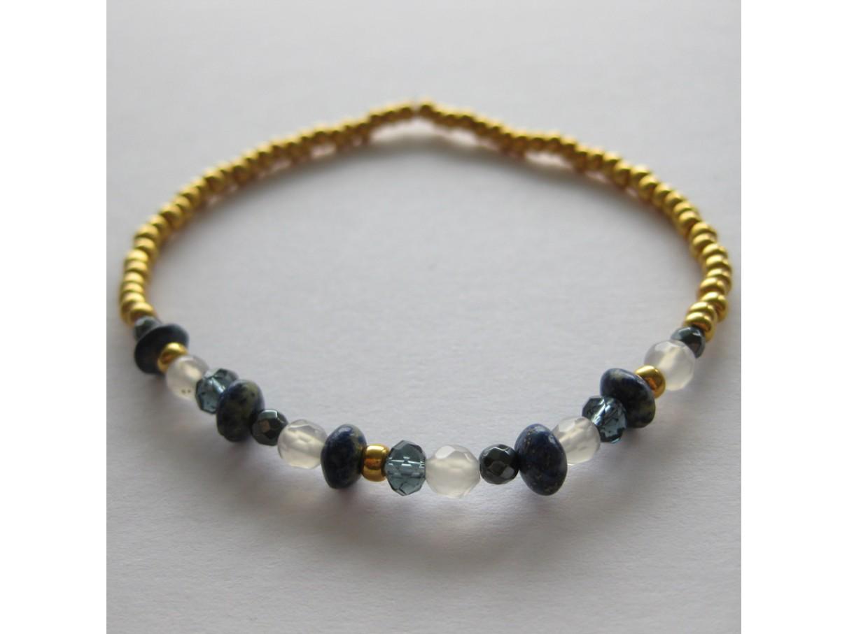Armbånd, guld med blå mix sten