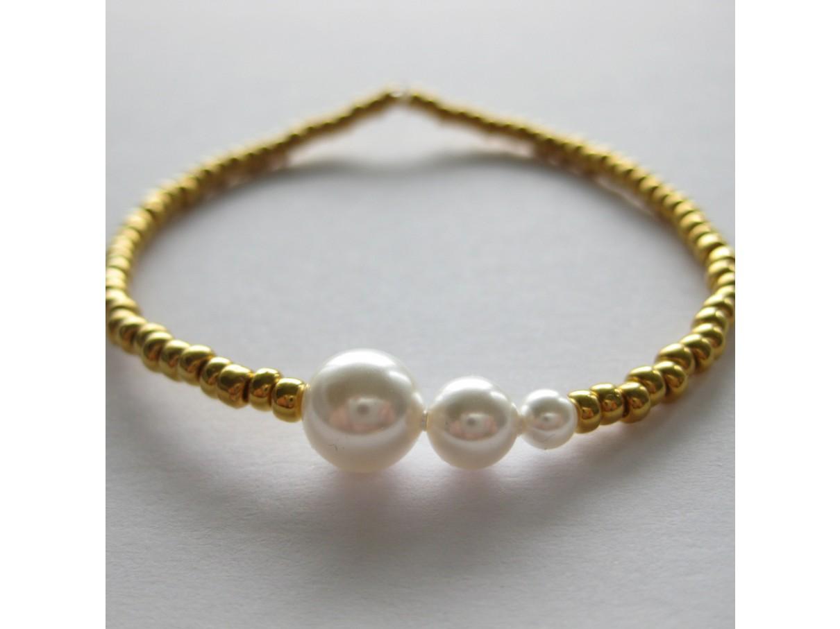Armbånd, guld med hvide perler