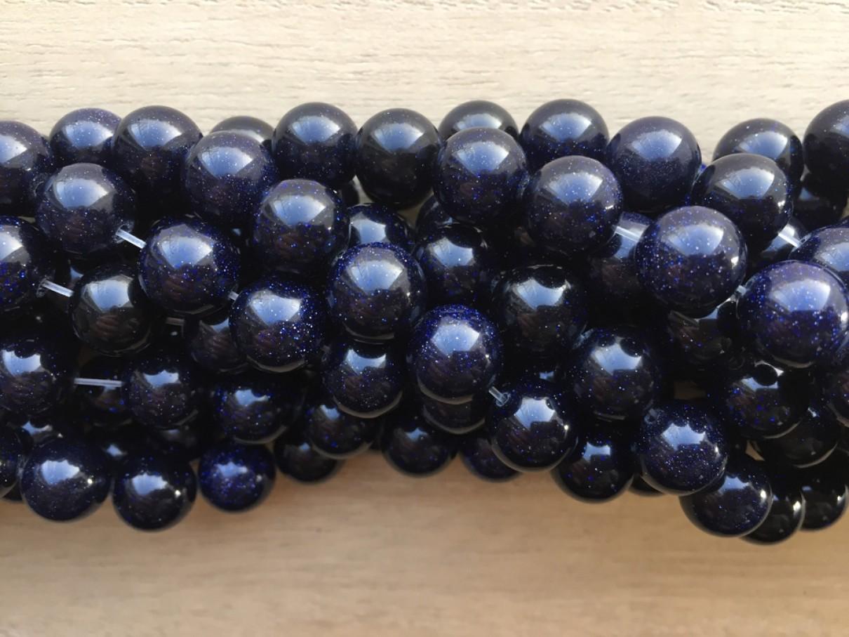 blå goldstone perler