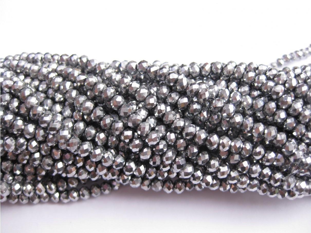 facetslebne glasperler sølv
