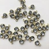 grå glasvedhæng med guldkant