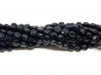 facetslebne mønter af sort spinel