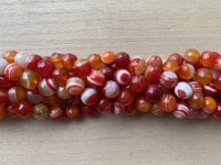 10mm facetslebne stribede orange perler