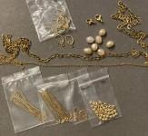 diverse gulddele i startpakke