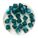 6mm Swarovski bicones emerald shimmer